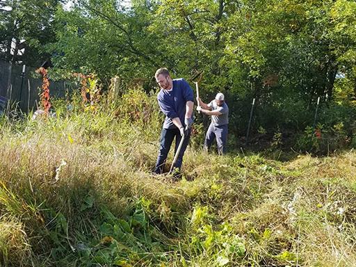 AmeriCorps VISTA volunteers work in community garden