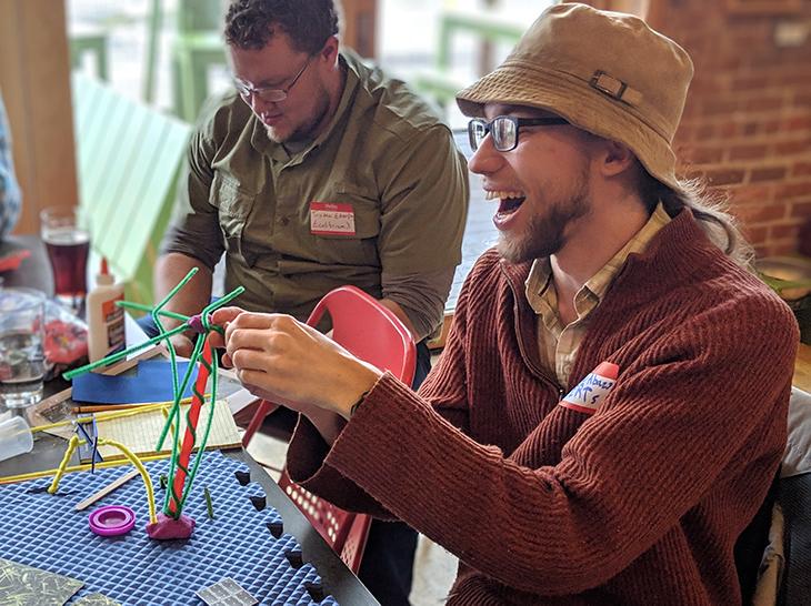 Participants at Solar Garden Design Event make models of solar panels.