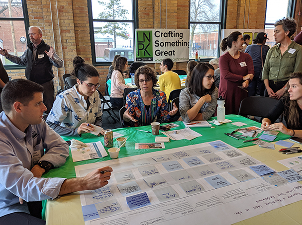 Community members discuss around tables during Local Foods Summit